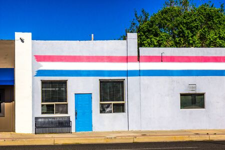 Vacant Building With Red, White & Blue Stripes