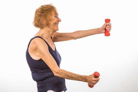 Small Senior Woman Exercises & Lifts Two Pound Dumbbells