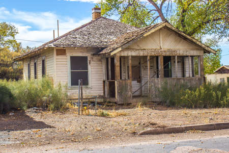 Old Abandoned One Level Home In Disrepair Stock Photo