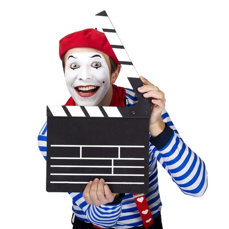 circus performers: Emotional funny mime actor wearing sailor suit, red beret posing on white background