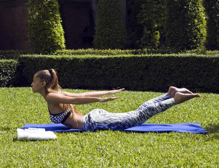 tropics: Yoga woman poses in tropics wearing stylish sportswear. Phuket, Thailand
