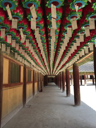Praying lanterns hanged on korea temple aisle