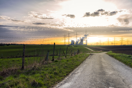rwe: Power station, transmission towers and winding road