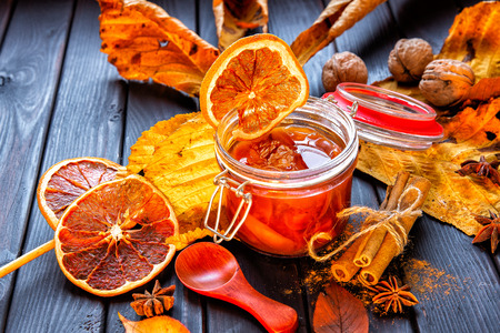 Apple-pumpkin jam with orange decorated with autumn leaves.Autumn season