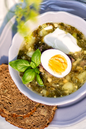 green soup with sorrel and egg .hot food. 版權商用圖片