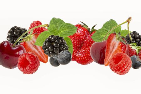 Assorted berries isolated on white background.Cherry,blueberry,raspberry, mulberry and mint leaves . Summer harvest Reklamní fotografie