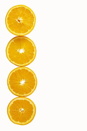 oranges cut into round slices isolated on white background. Tropical fruit