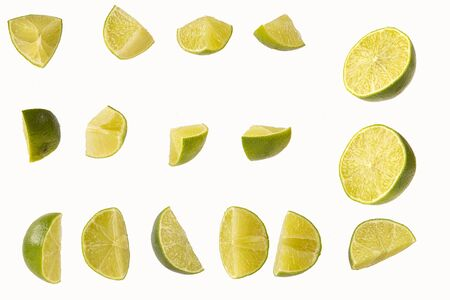 slices of cut lime isolated on white background Stock Photo