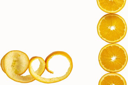 oranges cut into round slices with rind rolled into a spiral isolated on white background. Tropical fruit