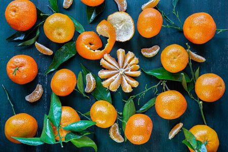 Clementines with leaves on a dark background .Fruits