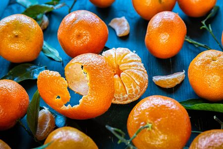 Clementines with leaves on a dark background .Fruits 스톡 콘텐츠 - 130064825