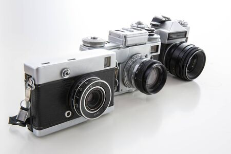 Old cameras isolated on white background. 版權商用圖片