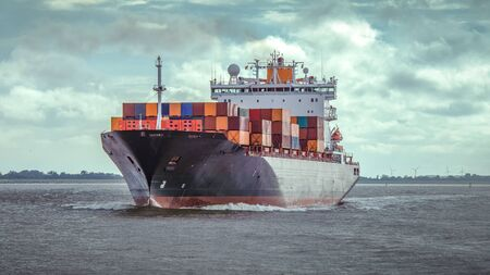 Container ship on the river on the river Elbe by Hamburg 写真素材