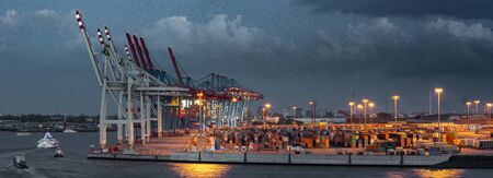 Container terminal in Hamburg in cloudy weather 写真素材