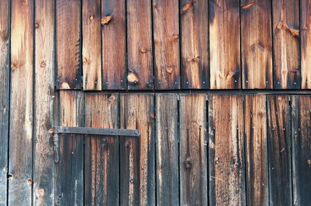 hinge: rough wood texture and a door hinge