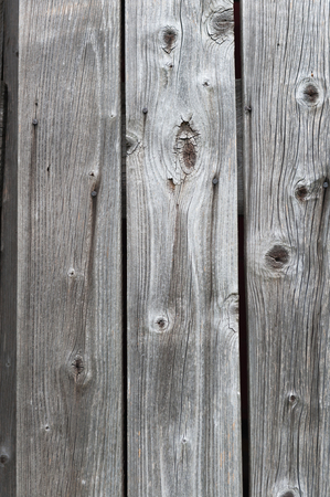 White wood with knotholes and nails