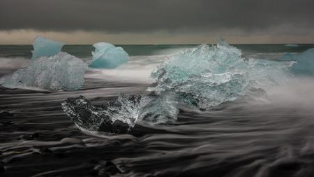 blue lagoon: Ice on black beach Stock Photo