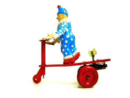 antique tricycle: old toy clown on a tricycle