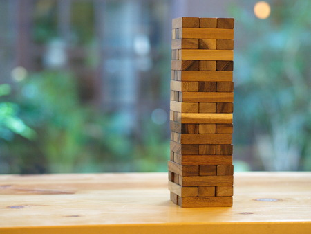 a Wooden Block Game. Wood Tower Contruction Cube Toy.