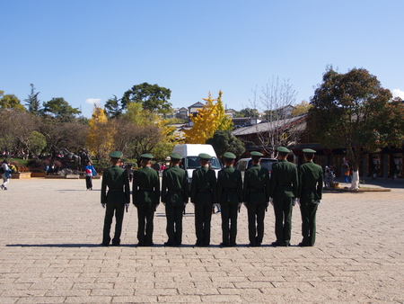 Chinese Police in Lijiang Old Town make secure for tourist.The UNESCO Heritage City. Travel in Lijiang, Yunnan Province, China in 2012, November 17th