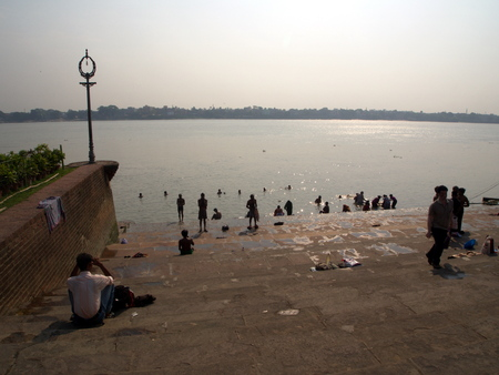 The Dakshineswar Kali Temple and indian peoples come to play a holy water from the Ganga river. Kolkata City, INDIA , 11th APRIL 2013