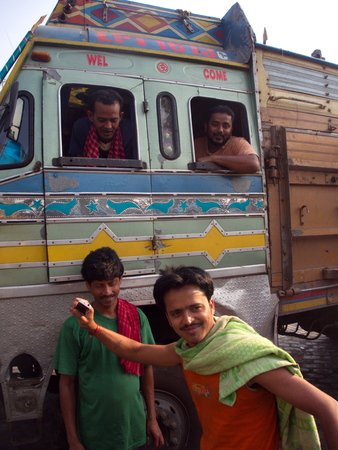 Indian Guy take action for a photo with a bus,Kolkata City, INDIA , 11th APRIL 2013.