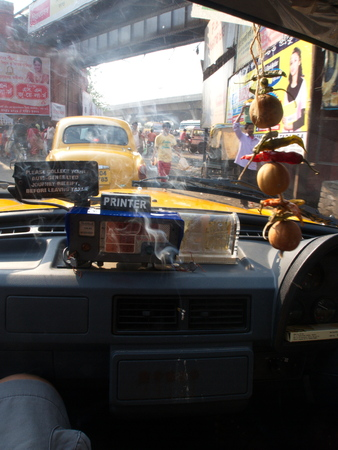 The God and smoke Inside the taxi,Kolkata City, INDIA , 11th APRIL 2013