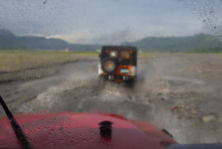 Blur in Car with the Big Rain and Storm on the way to Pinatubo Volcano. Travel in Clark, Philippines in 2013, 21th July.