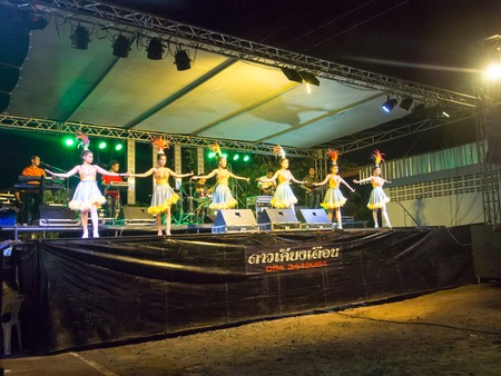 Local Concert with thai girl group dancing the Temple Event in Burirum Province, 22th April, 2018.
