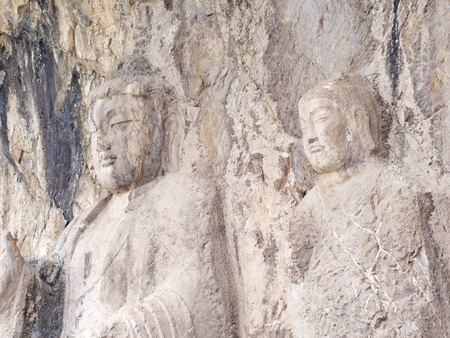 Luoyang Longmen grottoes. Buddha and the stone caves and sculptures in the Longmen Grottoes in Luoyang, China. Taken in 14th October 2018. 免版税图像