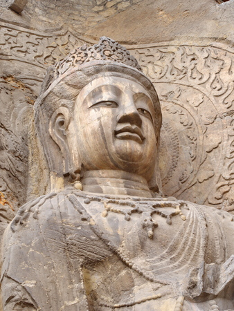 Luoyang Longmen grottoes. Broken Buddha and the stone caves and sculptures in the Longmen Grottoes in Luoyang, China. Taken in 14th October 2018.