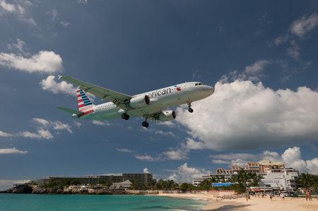 Maho Beach, Sint Maarten - 20th of October 2016: Low Flying Plane taken in 2015 Editorial