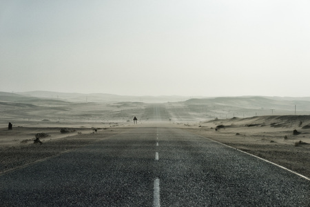 Sand Storm Across Lonely Desert Road in Southern Namibia taken in January 2018 Stock Photo