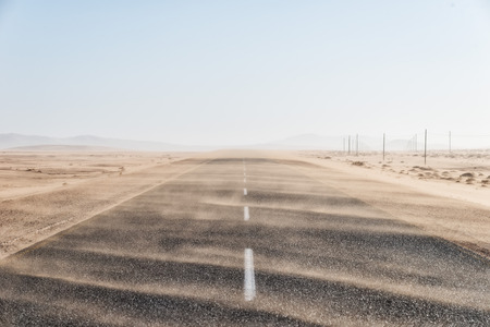 Sand Storm Across Lonely Desert Road in Southern Namibia taken in January 2018 Stock fotó