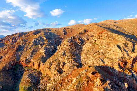 Sunset over Orange Cliffs Imagens - 128005384