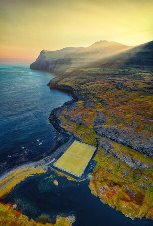 Eidi Soccer Field by the Ocean on the Faroe Islands, post processed in HDR