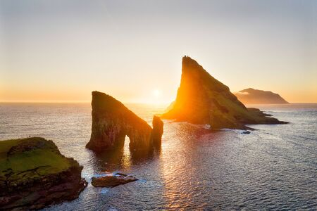 Drangarnir Rocks during Sunset in the Faroe Islands, Denmark, post processed in HDR
