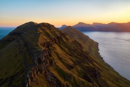 View along the cliffs of Funningur during sunrise on the Faroe Islands, post processed in HDR