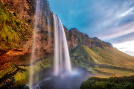 Seljalandsfoss Waterfall During Sunset in Southern Iceland, post processed in HDR Banco de Imagens