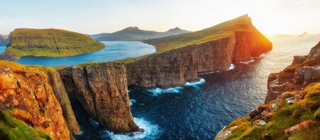 Sorvagsvatn Lake and Waterfall into the Ocean in Western Faroe Island, post processed in HDR
