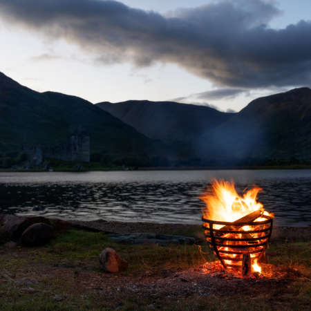 Camp Fire by the Lake in Scotland taken in August 2020, post processed using exposure bracketing