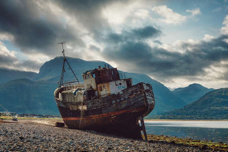 Old boat of Caol in front of Ben Nevis in Scotland, taken in August 2020, post processed using exposure bracketing