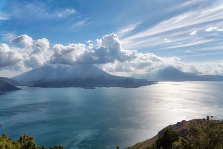 Lake Atitlan with Volcanos in the background in Guatemala , post processed using exposure bracketing