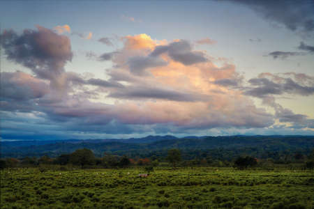 Sunset Clouds over Fields in Costa Rica, post processed using exposure bracketing Reklamní fotografie