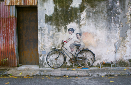 Little Children on a Bicycle or Sibling Cyclist Street Art Mural in Armenian Street, George Town, Penang Unesco Heritage Site by   Lithuanian artist Ernest Zacharevic Editorial