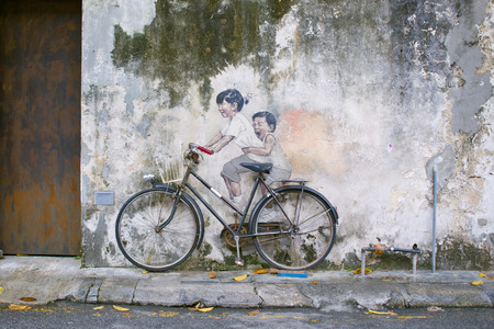 Little Children on a Bicycle or Sibling Cyclist Street Art Mural in Armenian Street, George Town, Penang Unesco Heritage Site by   Lithuanian artist Ernest Zacharevic 에디토리얼