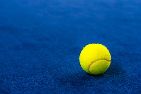 tennis balls on indoor court