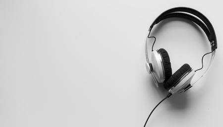 remix: Single headphones on a table