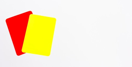 red and yellow cards on a white background Stock Photo