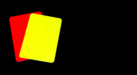 reprimand: red and yellow cards on a black background